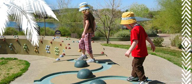 Children walking on decorative stone wall = Gilbert Arizona, Best Cities, Best Places to Live - Bill Salvatore, Arizona Elite Properties 602-999-0952 - Arizona Real Estate