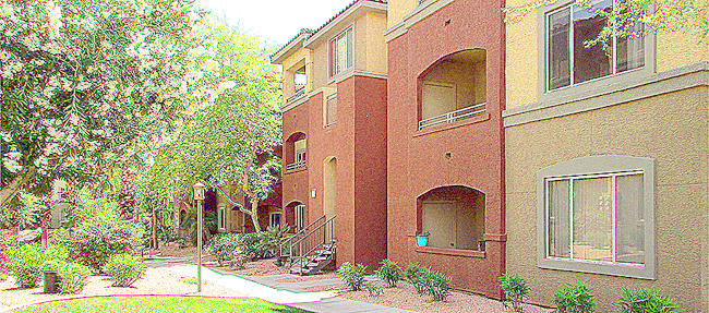 Exterior of condo building in soft, southwest colors - 5401 E Van Buren St, Phoenix Arizona - Red Rox Condominiums - Bill Salvatore, Arizona Elite Properties 602-999-0952