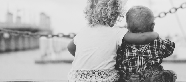 young girl with her arm around a baby boy - Kindest Cities, Best Places to Live, kindness, humanitarian, philanthropy - Bill Salvatore, Arizona Elite Properties 602-999-0952 - Arizona Real Estate