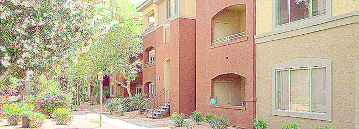 Exterior of 3-story condo building in soft, southwest colors - 5401 E Van Buren St, Phoenix Arizona - Red Rox Condominiums - Bill Salvatore, Arizona Elite Properties 602-999-0952