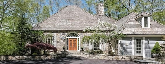 Gray stone home with mansard roof and wood double entry doors - Cyndi Lauper's Stamford CT home for sale (photo: RIS Media) - Bill Salvatore, Arizona Elite Properties 602-999-0952 - Arizona Real Estate