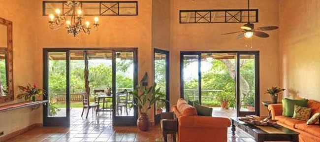 stucco walls and shining tile floor, wall of windows overlooking lush greenery - Mel Gibson's Costa Rica house for sale, Costa Rica Vacation property, Luxury home on Costa Rica - Bill Salvatore, Arizona Elite Properties 602-999-0952 - Costa Rica Real Estate for Sale