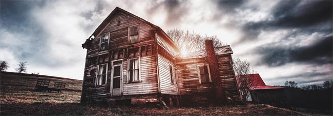 old delapitated home and mottled, dark sky - Selling a haunted house - Is my house haunted - Photo by bryan-minear on Unsplash - Bill Salvatore, Arizona Elite Properties 602-999-0952 - Arizona Real Estate