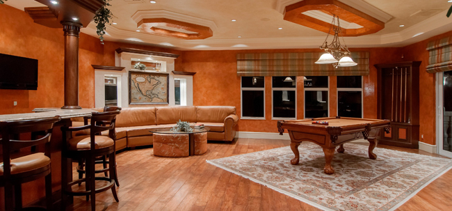 spacious room with wood floors, columns, walls and ceiling accents - luxury home, wood floors, wood accents - Bill Salvatore, Arizona Elite Properties 602-999-0952 - Arizona Real Estate Luxury Homes
